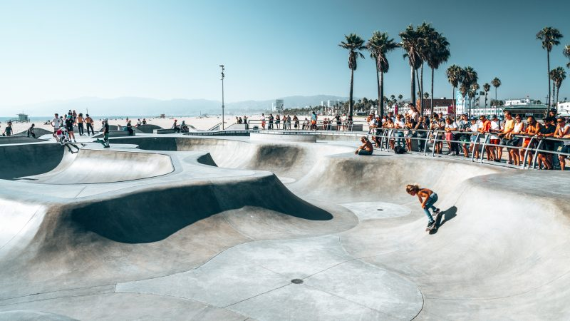 June 10, 2018. Los Angeles, USA. Venice beach skate park by the ocean. People skating at the skatepark showing different tricks.